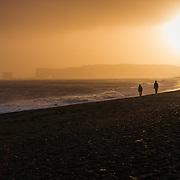 Sunset over the black beach in Vik