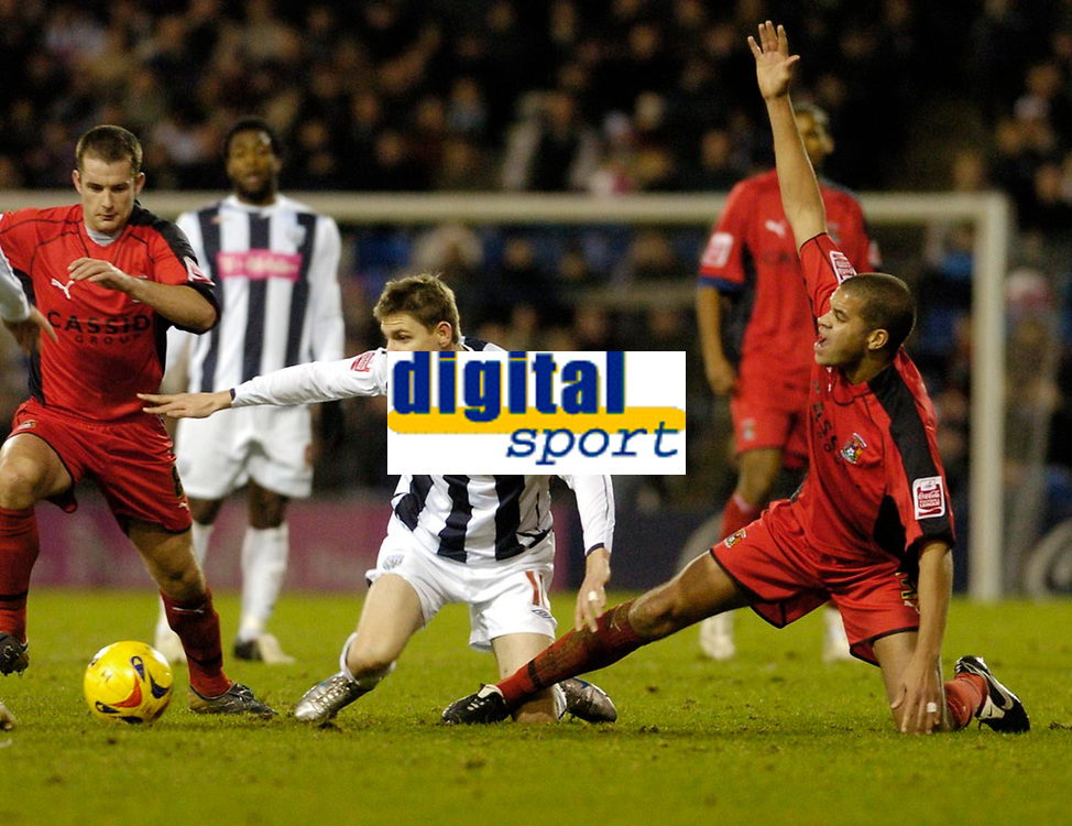 Photo: Leigh Quinnell.<br /> West Bromwich Albion v Coventry City. Coca Cola Championship. 16/12/2006. Coventrys Marcus Hall stops West Broms Zoltan Gera.