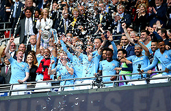 Manchester City's Vincent Kompany (second left) celebrates with the FA Cup Trophy after the final whistle