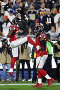 Atlanta Falcons rookie free safety Damontae Kazee (27) leaps and celebrates with Atlanta Falcons defensive end Courtney Upshaw (91) during the 2018 NFC Wild Card NFL playoff football game against the Los Angeles Rams, Saturday, Jan. 6, 2018 in Los Angeles. The Falcons won the game 26-13. (©Paul Anthony Spinelli)