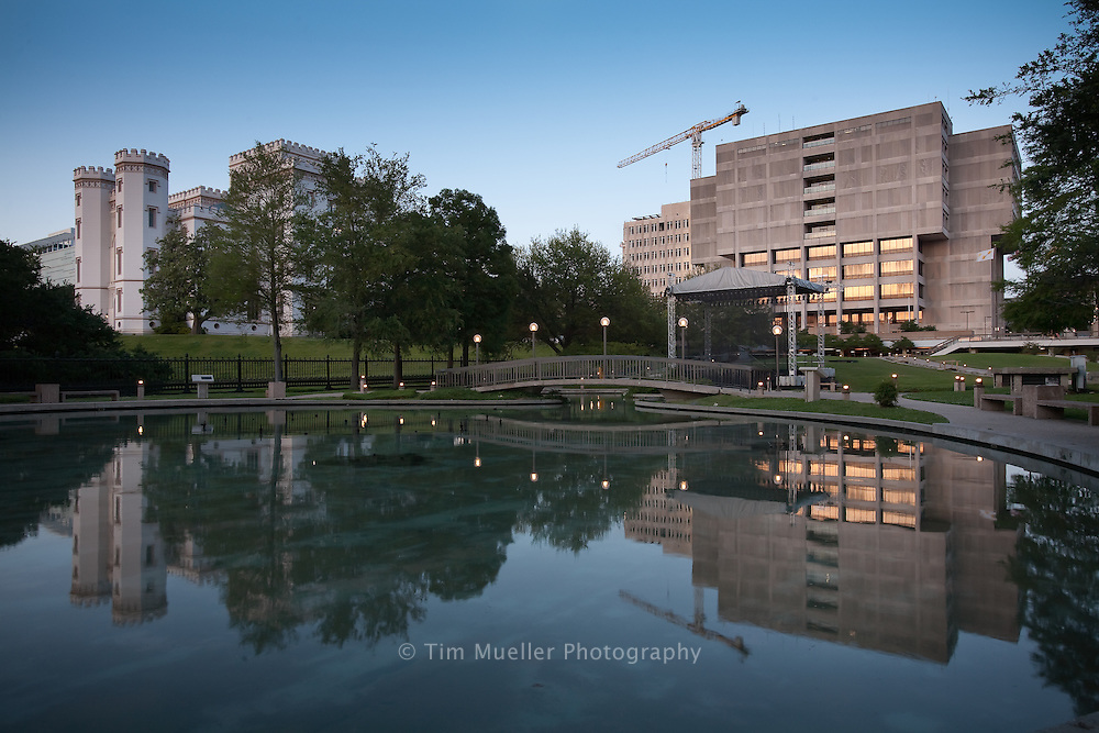 The Old State Capitol and the Baton Rouge Parish Governmental building, right, at dusk in downtown Baton Rouge.
