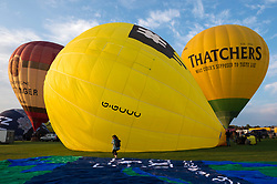 © Licensed to London News Pictures; 04/08/2021; Bristol, UK. Bristol International Balloon Fiesta - Fiesta Fortnight 2021. Fiesta Fortnight' sees its first mass balloon ascent on Wednesday, August 4 from Bristol's Elm Park. The Fiesta has never flown from this launch site before, and following a public survey, Elm Park was a hugely requested location to bring balloons. 'Fiesta Fortnight', will take place from Monday 2nd August to Sunday 15th August 2021 and will see hundreds of hot air balloons taking off from multiple locations across the city. The usual Bristol Balloon Fiesta event at Ashton Court is not happening this year because of the covid coronavirus pandemic. Photo credit: LNP.