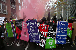 © Licensed to London News Pictures. 04/11/2015. London, UK. People dressed in black participate in a student demonstration here outside The Home Office in central London over tuition fees and cuts. Photo credit: Peter Macdiarmid/LNP