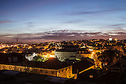 """The view from one f the balconies in one of the rooms at hotel """"Casa das Janelas com Vista"""", where 25th of April bridge and the summit of Basilica da Estrela can be seen."""