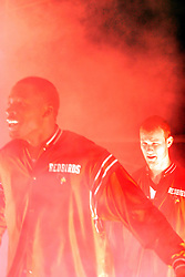 The Illinois State Redbird Men's basketball team makes their way to the floor through the smoke and lights.