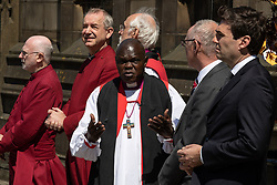 © Licensed to London News Pictures . 22/05/2018 . Manchester , UK . Dignitaries , including JOHN SENTAMU , SIR RICHARD LEESE and ANDY BURNHAM , wait to receive guests at Manchester Cathedral ahead of a Service of Remembrance on the first anniversary of the Manchester Arena bombing . On the evening of 22nd May 2017 , Salman Abedi murdered 22 people and seriously injured dozens more , when he exploded a bomb in the  foyer of the Manchester Arena as concert-goers were leaving an Ariana Grande gig . Photo credit : Joel Goodman/LNP
