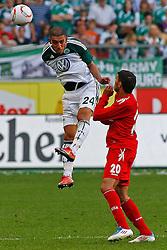 24.04.2010, Volkswagen Arena, Wolfsburg, GER, 1.FBL, VfL Wolfsburg vs 1.FC Koeln, im Bild Ashkan Dejagah (Wolfsburg #24) kommt vor Adil Chihi (Koeln #20) zum Kopfball .EXPA Pictures © 2011, PhotoCredit: EXPA/ nph/  Schrader       ****** out of GER / SWE / CRO  / BEL ******