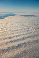 Aerial shot of undulating waves in stratus clouds of Coastal advection fog over the Pacific Ocean near San Francisco, California