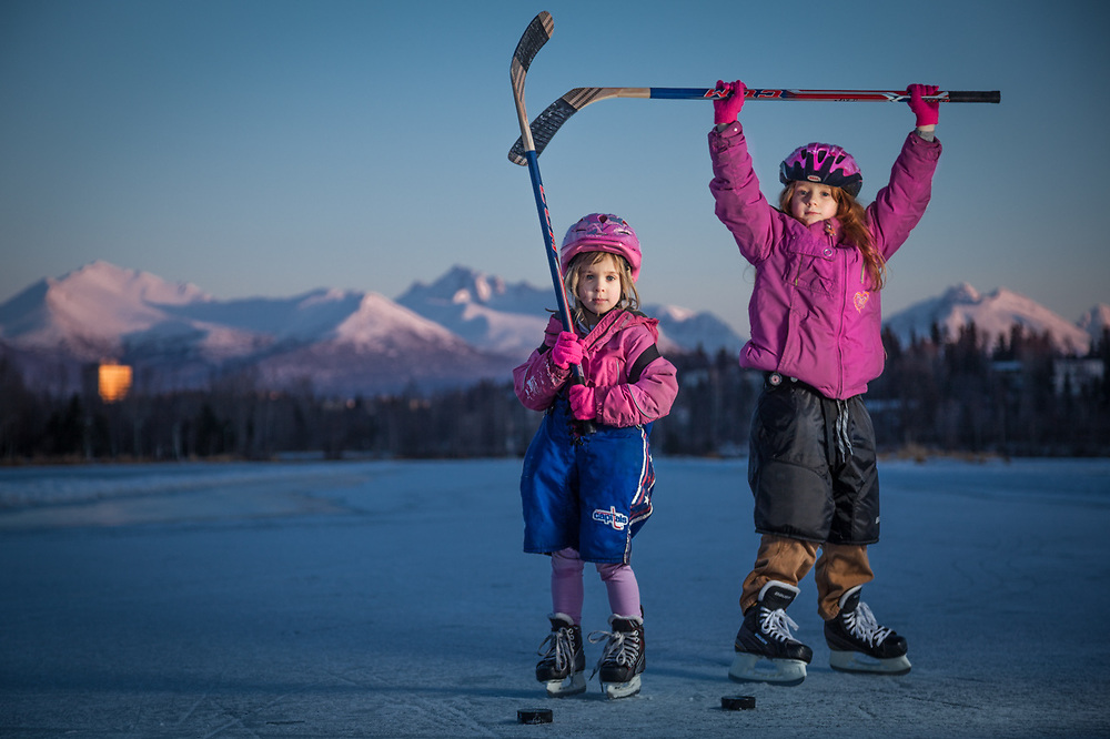 """Sisters Kavina (5) and Zakara (8) at Westchester Lagoon, Anchorage.  """"With the lack of snow this year, we needed to find an alternative to downhill skiing.  So, to get the girls out of the house, we started skating.  They love it!""""  -John Baumeister"""