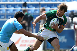 Ockert Kruger attacks for South Africa during the XIX Commonwealth Games 7s rugby match between South Africa and India held at The Delhi University in New Delhi, India on the  11 October 2010..Photo by:  Ron Gaunt/photosport.co.nz