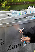 stocking up on the healing water at Lourdes France