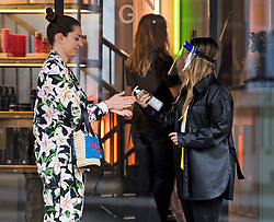 © Licensed to London News Pictures. 04/07/2020. London, UK. A customer is asked to use hand sanitiser before being allowed to enter George Northwood hair salon in Soho, as barbers and hairdressers are allowed to open for the first time since lockdown. Photo credit: Ben Cawthra/LNP