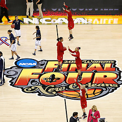 Apr 9, 2013; New Orleans, LA, USA; Connecticut Huskies and Louisville Cardinals players warm up before the championship game in the 2013 NCAA womens Final Four at the New Orleans Arena. Mandatory Credit: Derick E. Hingle-USA TODAY Sports