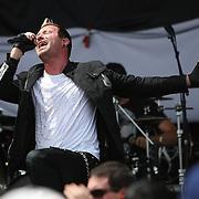 Lead singer Trevor McNevan of the band Thousand Foot Krutch sings onstage at the Rockstar Energy Drink Festival at the 1-800-Ask-Gary amphitheater in Tampa, Florida on Thursday, September 13, 2012. (AP Photo/Alex Menendez)