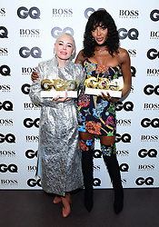 Rose McGowan with the Inspiration Award and Naomi Campbell with the Fashion Icon Award in the press room at the GQ Men of the Year Awards 2018 in Association with Hugo Boss held at The Tate Modern in London. PRESS ASSOCIATION Photo. Picture date: Wednesday September 5, 2018. See PA story SHOWBIZ GQ. Photo credit should read: Ian West/PA Wire