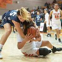 Piedra Vista's Bailey Rasmussen (15) and Gallup's Hailey Long (40) fight over possession of the ball Saturday, Dec. 7 at the John Lomasney 45th annual Gallup Girls Invitational Basketball Tournament championship game in Gallup.