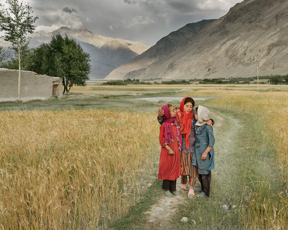 Portrait young girls. The traditional life of the Wakhi people, in the Wakhan corridor, amongst the Pamir mountains.