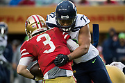 Seattle Seahawks defensive end Michael Bennett (72) sacks San Francisco 49ers quarterback C.J. Beathard (3) from the blindside at Levi's Stadium in Santa Clara, Calif., on November 26, 2017. (Stan Olszewski/Special to S.F. Examiner)