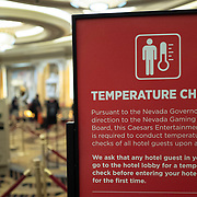 Temperature check signs alert visitors at a hotel in Las Vegas, Nevada on Monday, October 19, 2020. (Alex Menendez via AP)