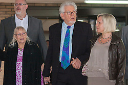 London, May 19th 2014. Rolf Harris leaves Southwark Crown Court after another day of his trial on 12 counts of indecent assault, accompanied by his niece  his wife Alwen, left, and his daughter Bindi, right.