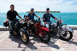 Andrea Labarbara, Loring Hill (L) and Mark Hill (R) of the Wolf Pack (4-cylinder bikes) on the Cross Country Chase motorcycle endurance run from Sault Sainte Marie, MI to Key West, FL. (for vintage bikes from 1930-1948). The Grand Finish in Key West's Mallory Square after the 110 mile Stage-10 ride from Miami to Key West, FL and after covering 2,368 miles of the Cross Country Chase. Sunday, September 15, 2019. Photography ©2019 Michael Lichter.