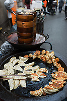traditional chinese  fried ravioli gioza jiaozi street food cuisine in Shanghai in the popular republic of China