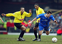 Photograph: Scott Heavey.<br /> Watford v Chelsea. FA Cup Third Round. 03/01/2004.<br /> Frank Lampard is tripped by Paolo Vernazza