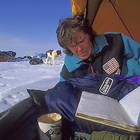 INTERNATIONAL ARCTIC PROJECT, Will Steger updates journal in camp on frozen Arctic Ocean, Northwest Territories, Canada.