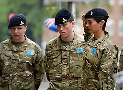 © London News Pictures. 31/05/2013. Woolwich, UK. A Cadets from the Royal Artillery barracks in Woolwich salutes after laying flowers and paying respects at the scene where Drummer Lee Rigby was killed in Woolwich, South East London. Photo credit: Ben Cawthra/LNP