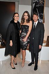 Left to right, Valentino designer MARIA GRAZIA CHIURI, ELIZABETH HURLEY and Valentiono designer PIER PAOLO PICCIOLI at a private view of 'Valentino: Master Of Couture' at Somerset House, London on 28th November 2012.