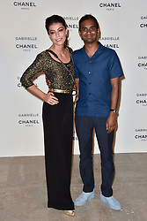 """Alessandra Mastronardi, Aziz Ansari attending the party for the new Chanel perfume """"Gabrielle"""", at the Palais de Tokyo in Paris, France, on July 4, 2017. Photo by Alban Wyters/ABACAPRESS.COM"""