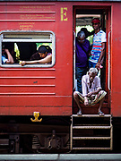 07 OCTOBER 2017 - COLOMBO, SRI LANKA: Passengers on a 3rd class train at the Fort Station in Colombo. The Fort Station is Colombo's main train station and serves as the hub of Sri Lanka's train system. The station opened in 1917 and is modeled after Manchester Victoria Station.    PHOTO BY JACK KURTZ