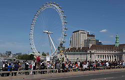 """© Licensed to London News Pictures. 22/06/2020. London, UK. Protestors demonstrating against vaccines, 5G technology and Covid-19 rules and regulations march onto <br />  Westminster Bridge in central London. Later Boris Johnson is expected to announce a new """"one metre plus"""" social distancing rule as part of efforts to restart Britain's economy amid the Covid-19 crisis. Photo credit: Marcin Nowak/LNP"""