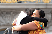 San Francisco, USA. 19th January, 2019. The Women's March San Francisco begins with a rally at Civic Center Plaza in front of City Hall. Poet Terisa Siagatonu receives a strong embrace on stage after a powerful poetry reading for the crowd assembled for the rally. Siaganu is an award-winning poet, arts educator, community organizer, and mental health advocate born in the Bay Area. She is the recipient of President Obama's Champions of Change Award. Credit: Shelly Rivoli/Alamy Live News