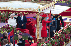 © Licensed to London News Pictures. 03/06/2012. .London, England. .Her Majesty The Queen, Kate Middleton and Prince William onboard the Royal Barge Gloriana at The Thames river pageant. The Royal Jubilee celebrations. Great Britain is celebrating the 60th  anniversary of the countries Monarch HRH Queen Elizabeth II accession to the throne this weekend Photo credit : LNP