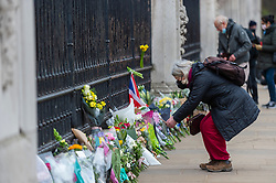 © Licensed to London News Pictures. 10/04/2021. LONDON, UK. Well wishers arrive with flowers outside Buckingham Palace after the death of Prince Philip, aged 99, was announced the previous day.  Photo credit: Stephen Chung/LNP