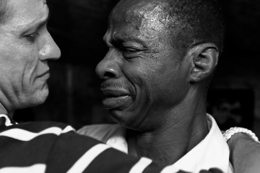 Recovering cocaine addicts Benji A. and Fred M. shed tears of joy and embrace following a group meeting. Benji and Fred became close friends while living and working together at the facility.