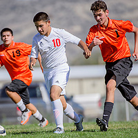 Grants Pirate Gaven Michael (10) breaks away from Gallup Bengals Christopher Mazon (1) and Tyler Watson (19) Thursday at Grants High School.