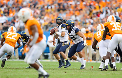 Sep 1, 2018; Charlotte, NC, USA; West Virginia Mountaineers quarterback Will Grier (7) drops back to pass during the third quarter against the Tennessee Volunteers at Bank of America Stadium. Mandatory Credit: Ben Queen-USA TODAY Sports