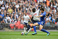 Football - 2017 / 2018 Premier League - Tottenham Hotspur vs. Leicester City<br /> <br /> Tottenham Hotspur's Moussa Sissoko shoots at goal despite the efforts of Leicester City's Harry Maguire, at Wembley Stadium.<br /> <br /> COLORSPORT/ASHLEY WESTERN