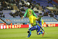 West Bromwich Albion defender Kyle Bartley (5) climbs on Wigan Athletic forward Joe Garner (14) to get to the ball during the EFL Sky Bet Championship match between Wigan Athletic and West Bromwich Albion at the DW Stadium, Wigan, England on 11 December 2019.