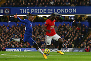 Forward Michy Batshuayi of Chelsea  and Defender Eric Bailly of Manchester United compete for the ball during the English Premier League match between Chelsea and Manchester United, Monday, Feb. 17, 2020, at Stamford Bridge, in London, United Kingdom. Manchester United defeated Chelsea 2-0.  (Mitchell Gunn/Image of Sport)