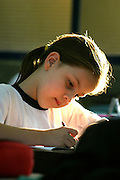 Sao Paulo_SP, Brasil. ..Aluna da 1a serie do turno da tarde durante a aula de Portugues. Escola Estadual Brigadeiro Gaviao Peixoto...A student during the Portuguese classroom. Estate School Brigadeiro Gaviao Peixoto...Foto: LEO DRUMOND / NITRO