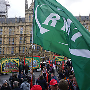 Parliament, London,England,UK. 26th April 2017. Members of the National Union of Rail, Maritime and Transport Workers (RMT) protest outside Parliament, marking the 1st anniversary of industrial action against Southern Rail regarding their proposal to extend (DOO) Driver Only Operation. by See Li