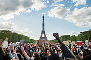 June, 6th, 2020 - Paris, Ile-de-France, France: Eiffel tower in background with Black Lives Matter demonstration, at Champs de Mars near Eiffel Tower, protesting the deaths of Black French youths who have died in French police custody and George Floyd in USA. In international solidarity against police brutality, concerning the recent murder of George Floyd in Minneapolis USA. Nigel Dickinson/Polaris