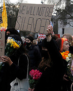 """A woman holds a sign that reads """"we will not be silenced"""" in response to the recent protest restriction bill. London. 15th March 2021"""