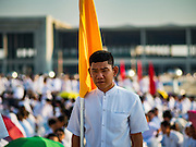"""11 FEBRUARY 2016 - KHLONG LUANG, PATHUM THANI, THAILAND: People walk into the pagoda during the Makha Bucha Day service at Wat Phra Dhammakaya.  Makha Bucha Day is a public holiday in Cambodia, Laos, Myanmar and Thailand. Many people go to the temple to perform merit-making activities on Makha Bucha Day, which marks four important events in Buddhism: 1,250 disciples came to see the Buddha without being summoned, all of them were Arhantas, or Enlightened Ones, and all were ordained by the Buddha himself. The Buddha gave those Arhantas the principles of Buddhism. In Thailand, this teaching has been dubbed the """"Heart of Buddhism."""" Wat Phra Dhammakaya is the center of the Dhammakaya Movement, a Buddhist sect founded in the 1970s and led by Phra Dhammachayo. Makha Bucha Day is one of the most important holy days on the Thai Buddhist calender.      PHOTO BY JACK KURTZ"""