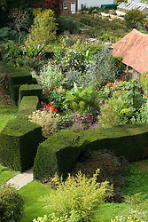 Overhead view of the exotic garden at Great Dixter enclosed by yew hedges