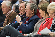 DALLAS, TX - DECEMBER 17: Former President George W. Bush and his wife Laura Bush look on during a game between the SMU Mustangs and the Hampton Pirates on December 17, 2015 at Moody Coliseum in Dallas, Texas.  (Photo by Cooper Neill/Getty Images) *** Local Caption *** George W. Bush, Laura Bush