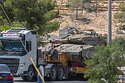 Israel Defence Force (IDF) is transporting a Mekavah Tank on a Tank carriers. Photographed in Israel